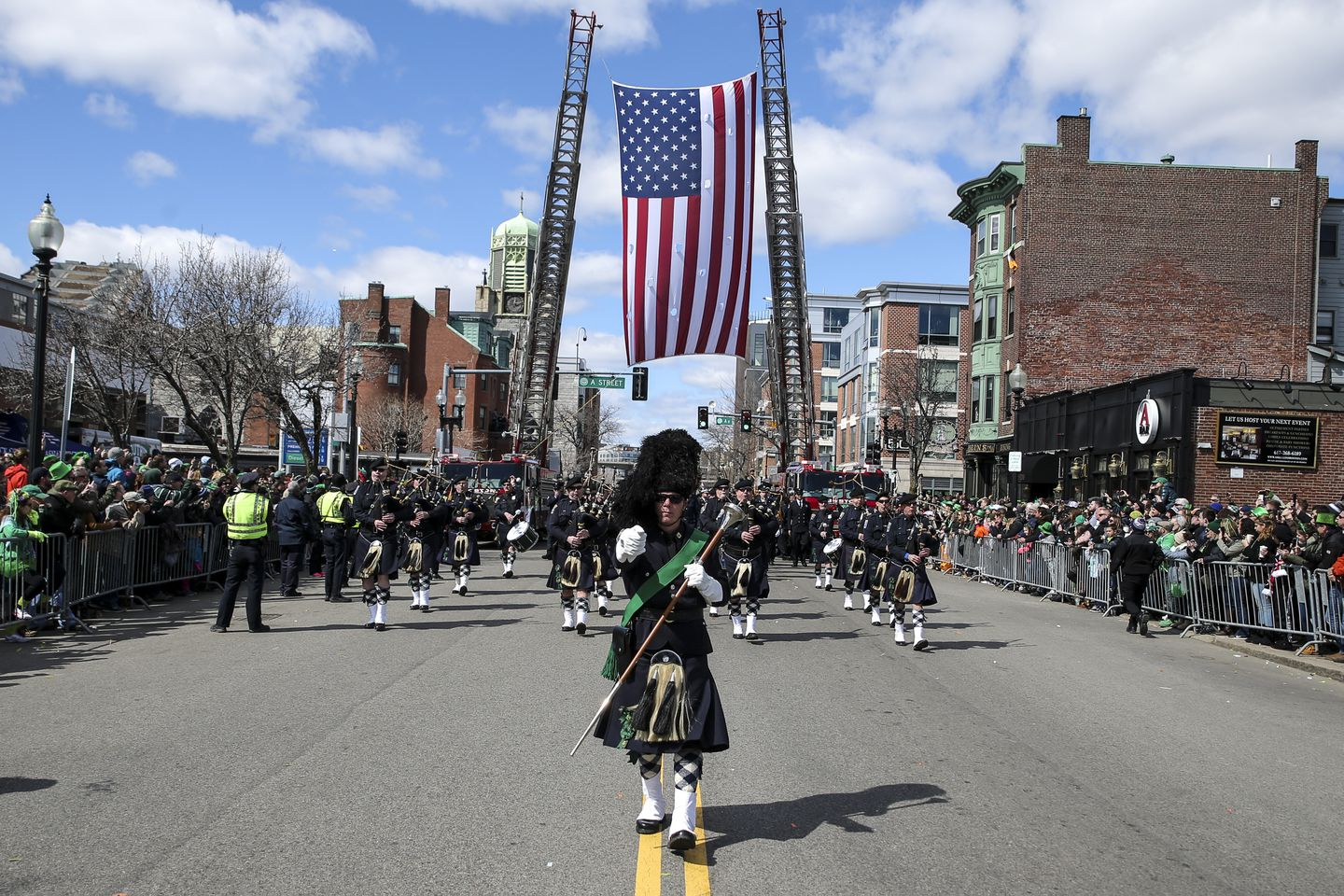 A pipes-and-drum band marches in the St. Patrick's Day parade in South Boston last year.
