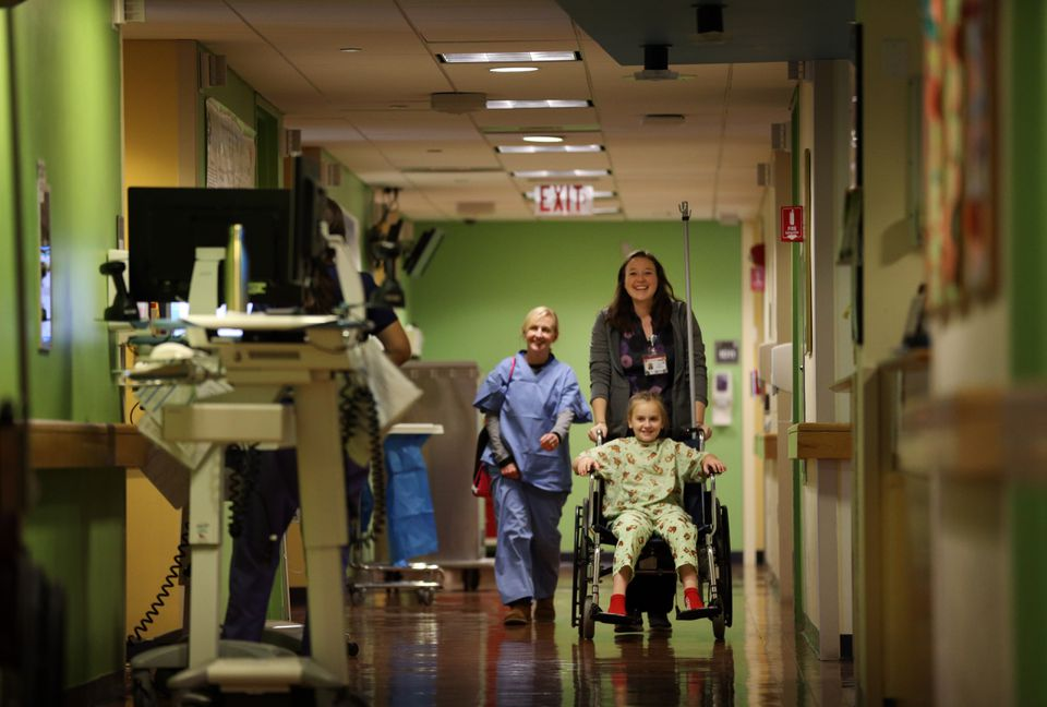 Sheila Quinn (left) followed her daughter Mia Quinn, 11, who was being prepared for an adenoidectomy at Mass. Eye and Ear.