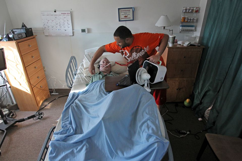 Dennis Heaphy, a quadriplegic, is pleased with his coverage under One Care. He says it helped him get a hospital bed in his apartment and a machine that helps him cough.