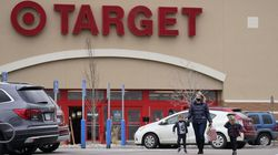 Shoppers leave a Target store Friday, March 12, 2021, in Centennial, Colo.