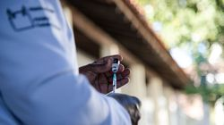 A health care worker prepares to administer a dose of the Pfizer-BioNTech COVID-19 vaccine.