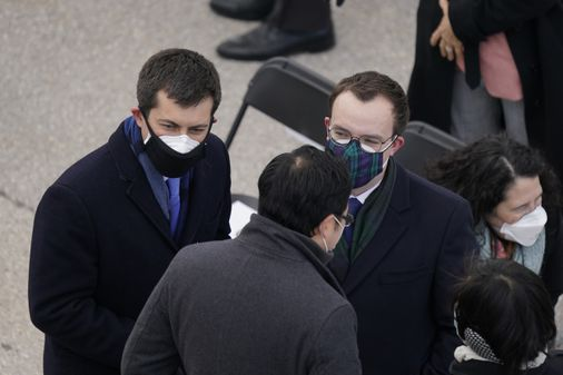 Why more people are starting to wear two masks