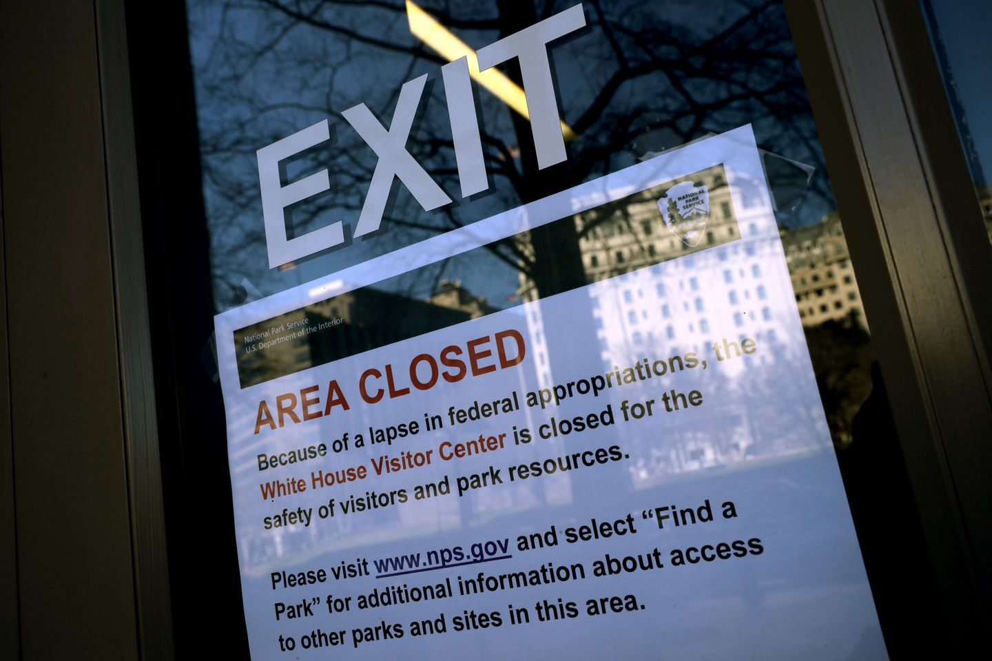 A sign in the window of the White House Visitors Center notified visitors that it is closed due to the partial federal government shutdown.
