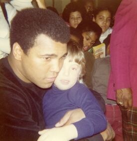 Muhammad Ali greeted children at the Elma Lewis School of Fine Arts in 1977.
