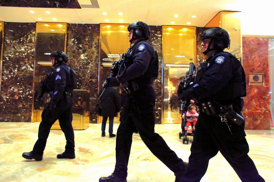 New York Police Department counterterrorism officers patrol inside Trump Tower.