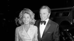 "This Nov. 5, 1971 photo shows actor Kirk Douglas and his wife Anne at the premier of ""Fiddler on the Roof"" in Los Angeles. Ms. Douglas died Thursday."