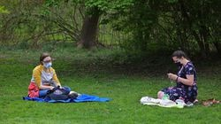 Friends Susannah Davis (left) and Madeline Gardner in Griggs Park. Masks are still required in outdoor spots in Brookline.