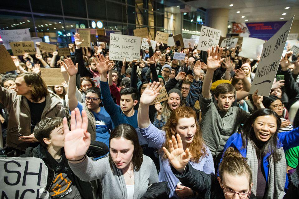 Demonstrators flocked to Logan International Airport Saturday night.