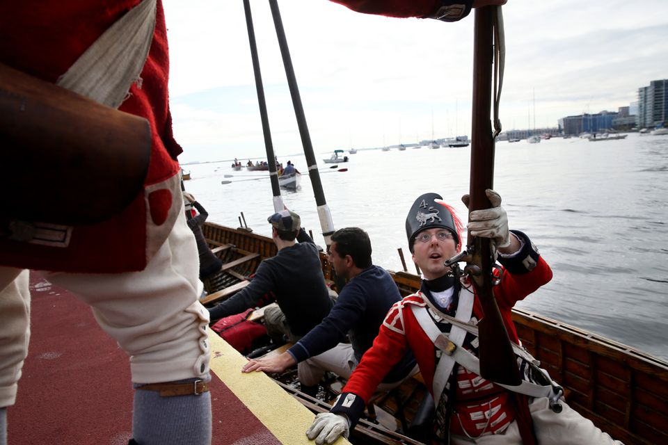Eli Huebner disembarked from a long boat  at Long Wharf.