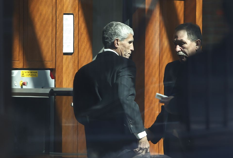 "Business owner William ""Rick"" Singer (left) walked into Federal Court."
