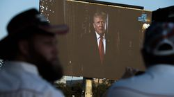 """A message from former president Donald Trump plays on a video screen during a """"Let Us Worship"""" prayer service on the National Mall on Sept. 11 in Washington, D.C."""