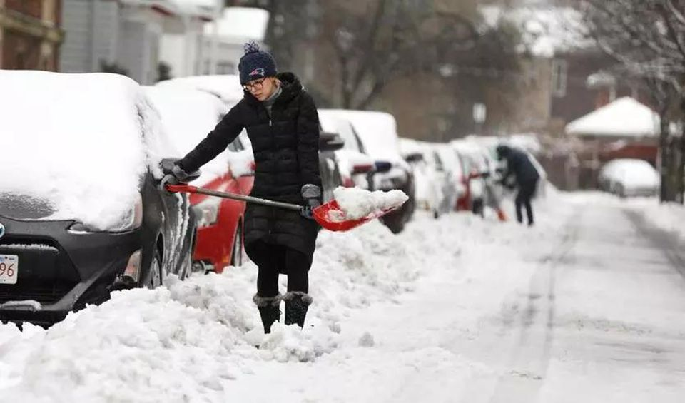 Residents on Lakeville Road in Jamaica Plain worked to clear out their vehicles on Sunday.