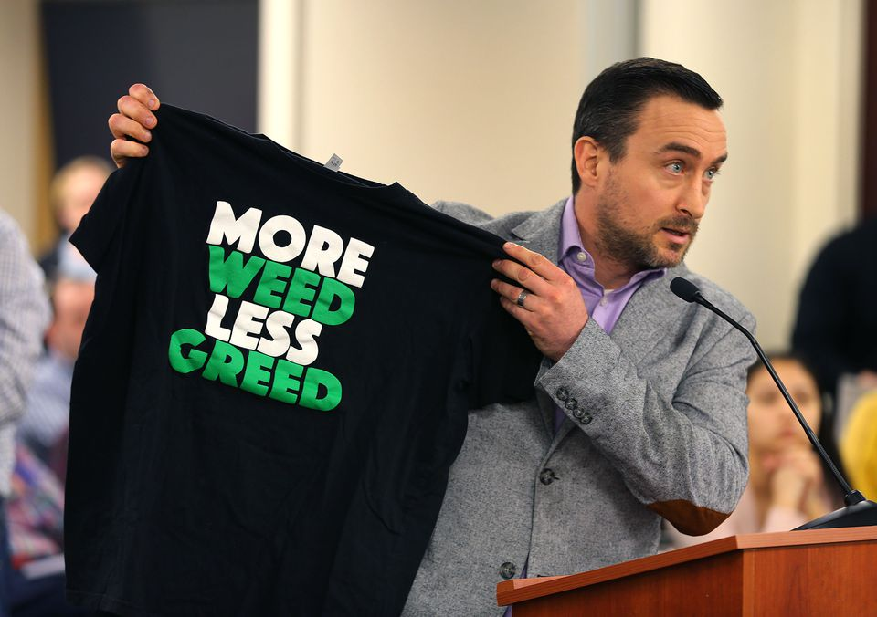 Andrew Mutty, cofounder of Beanton Greentown, a marijuana cultivation and clothing company, held up a T-shirt as he spoke before the Massachusetts Cannabis Control Commission in a so-called listening session in Boston Wednesday.