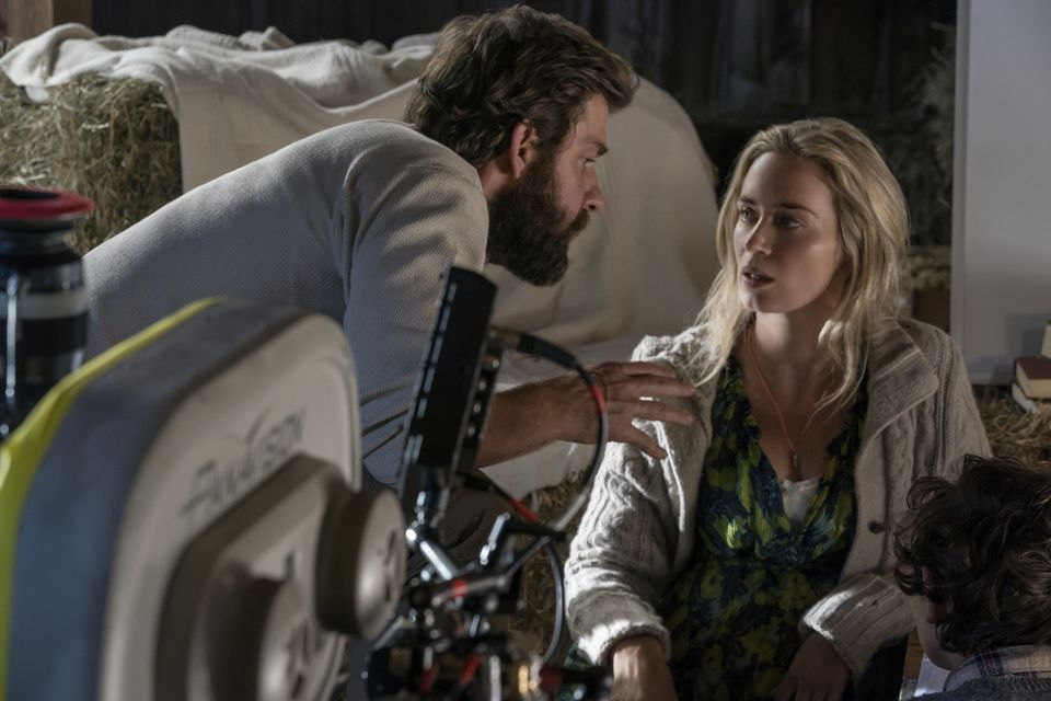 """John Krasinski on the set of """"A Quiet Place"""" with Emily Blunt."""