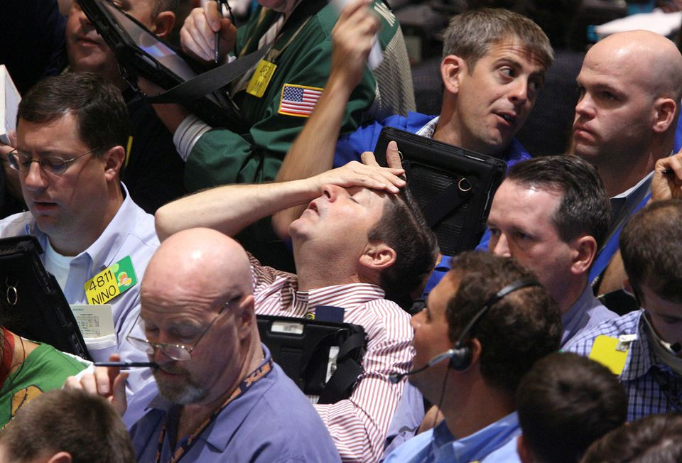 Traders in the product options pit at the New York Mercantile Exchange on Sept. 16, 2008. Lehman Brothers, formerly a titan of Wall Street, slid into bankruptcy on Sept. 15.