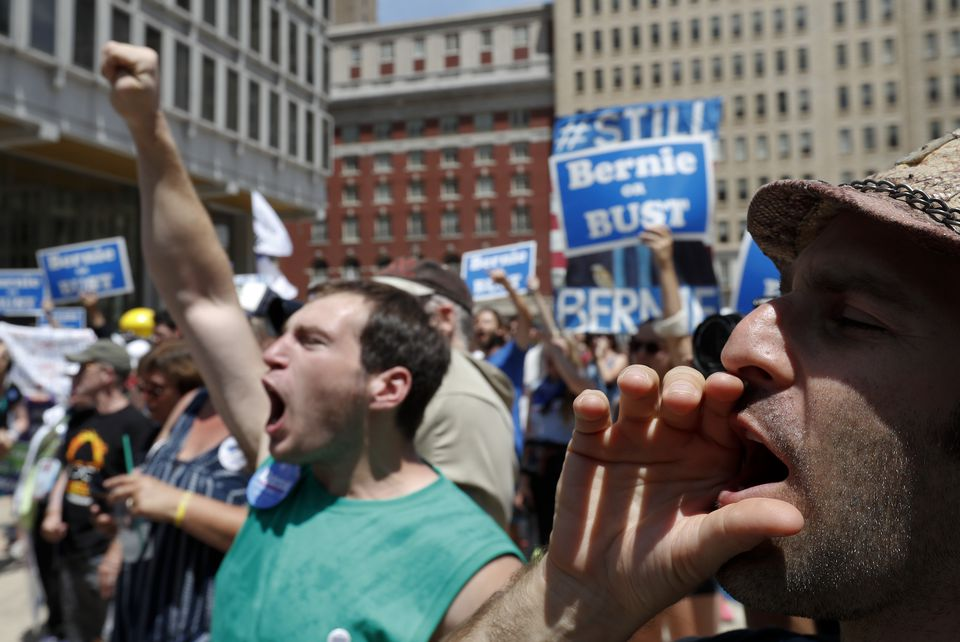 Supporters of Bernie Sanders protested in the streets of Philadelphia the day after the senator from Vermont called for party unity at the Democratic National Convention.