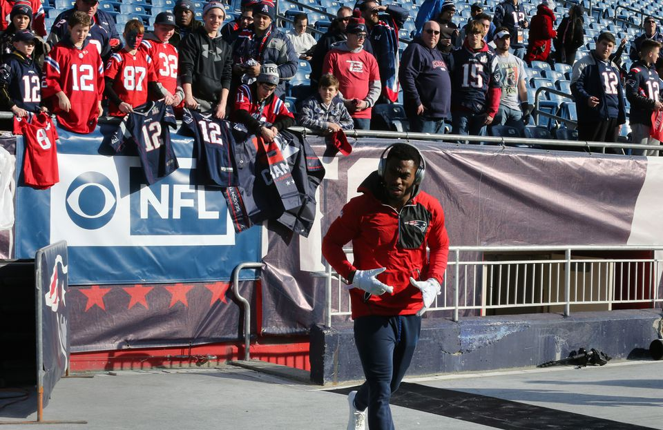 Patriots receiver Brandin Cooks came out to warm up as fans looked on from the stands.