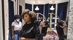Gueinah Blaise (left) watched her cousin Nathalie Fanfan, a personal shopper and stylist, have her outfit adjusted by Alice and Olivia store manager Michael Boissy.