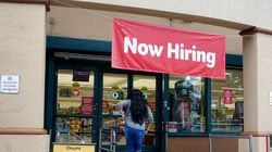A sign advertises job openings at a Winn-Dixie Supermarket in Hallandale, Fla. The number of Americans applying for unemployment aid rose last week for a second straight week.