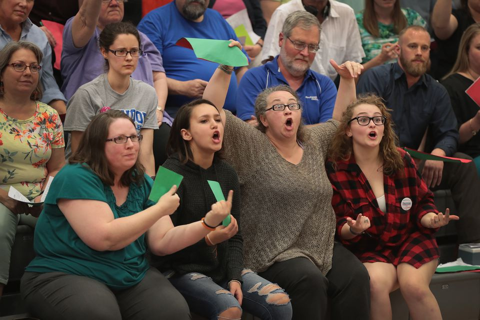 Guests react to US Representative Rod Blum during a town hall meeting on May 9 in Cedar Rapids, Iowa.  Would an e-mail be more effective? Maybe not.