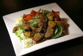 The beef version of  Fusion Food's sauteed coconut curry lemongrass dish.