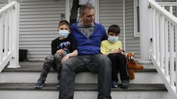Tim Langan posed at his home in Somerville with his two sons, Max (left), 9, and Dylan, 8.