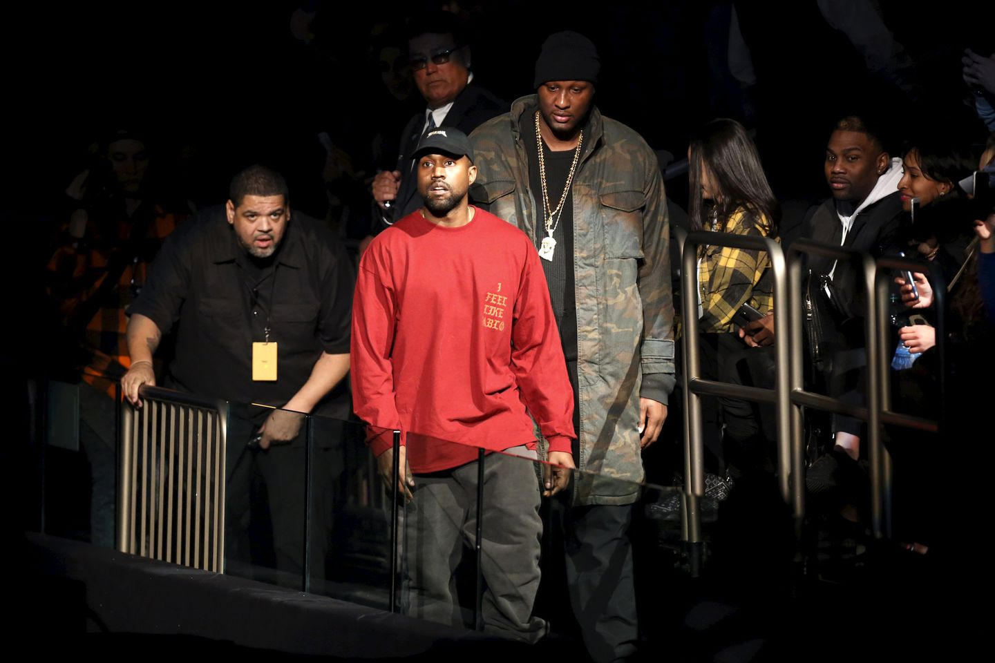 7be8bab24c0cc Kanye West (center) and Lamar Odom arrived at West s Yeezy Season 3  presentation and
