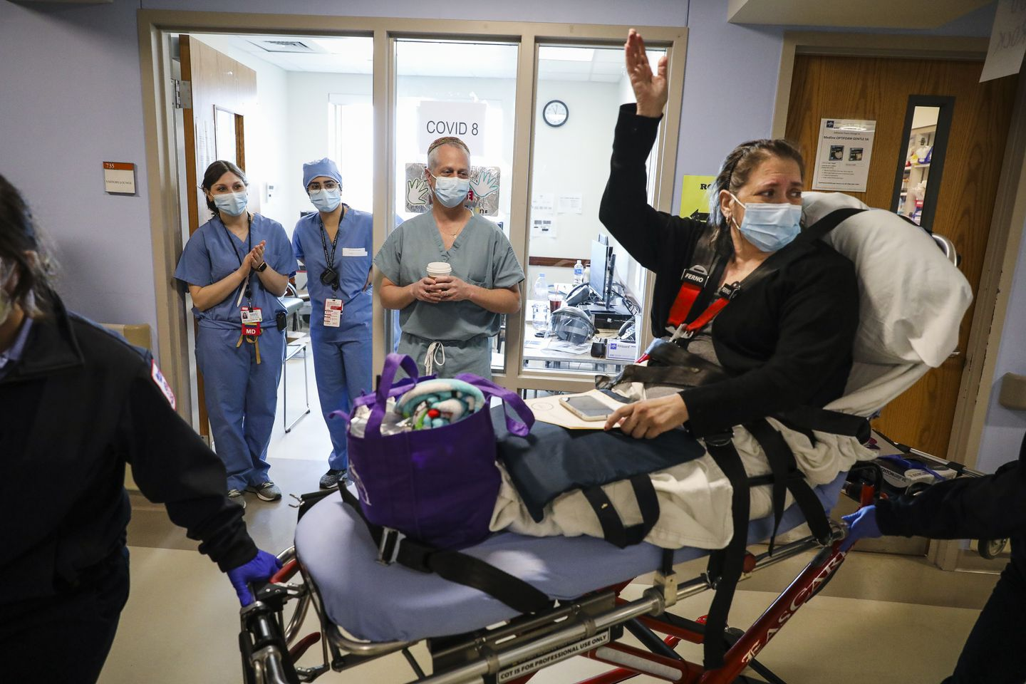 Boston Medical Center patient Candace Samayoa waved goodbye to nurses as she was being released from the hospital. Samayoa had been admitted to BMC two weeks earlier after testing positive for COVID-19.
