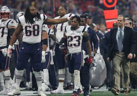 Patriots offensive tackle LaAdrian Waddle gives Patrick Chung a reassuring pat after the hybrid safety broke his right arm and left the game in the third quarter.
