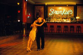 "John J. (Robert Duvall) gets a tango lesson from Manuela (Luciana Pedraza) in ""Assassination Tango."""