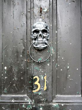 A knocker on a door on North Street in Plymouth reflects the darker side of the city's long history.