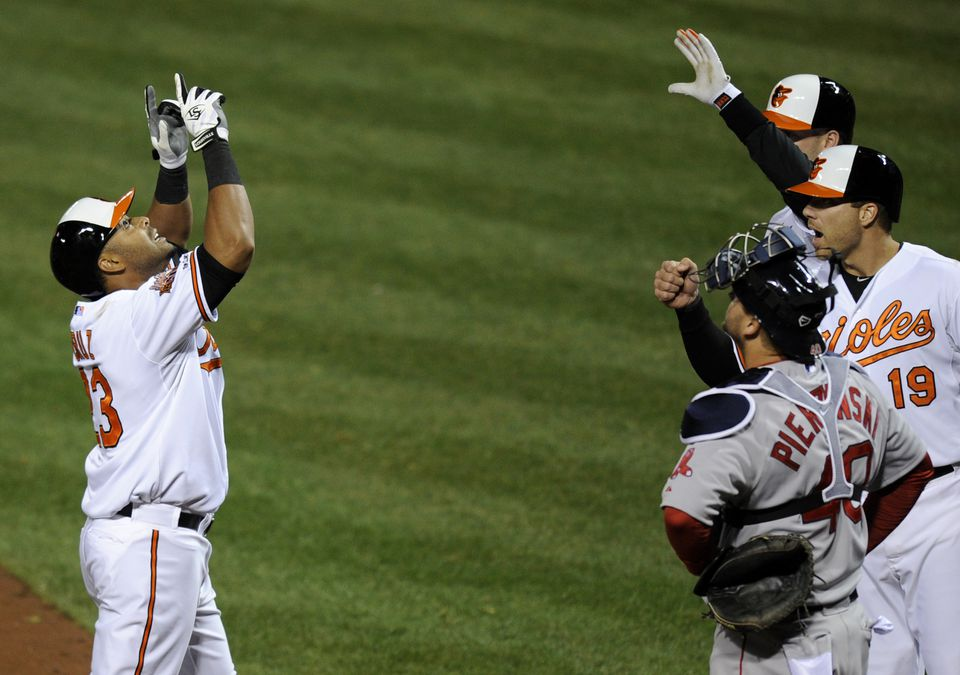 Nelson Cruz (left), who usually raises his game against the Red Sox, belted a two-run home run in the fourth inning Baltimore on Wednesday.