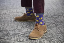 Tahir Quee shows off his duck socks on a Formal Thursday at Reveneer in Woburn.