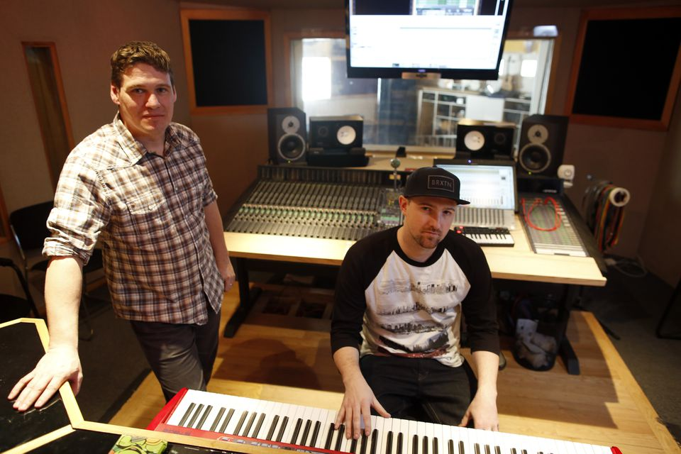 Owen Curtin (left) and Janos Fulop (a.k.a. The Arcitype) at their West Cambridge studio, which has two recording rooms, a lounge, and a performance stage.