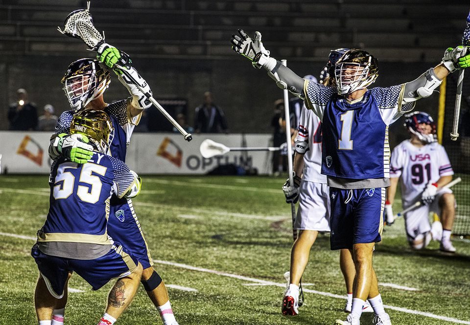 The MLL All-Stars celebrate a goal against Team USA in last summer's mathcup at Harvard Stadium.