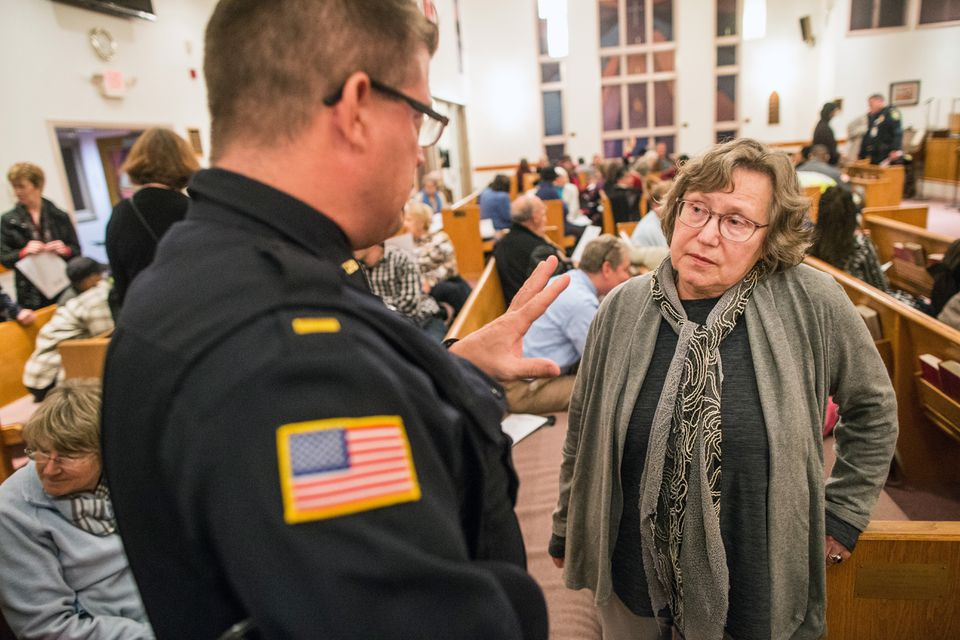 Lieutenant Dave Brown spoke with ECCO member Karen Brown at a meeting between Lynn police and residents held at Zion Baptist Church.