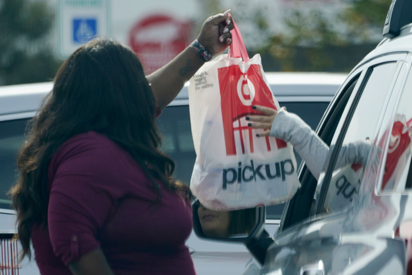A Target employee handed a customer a curbside pickup purchase.