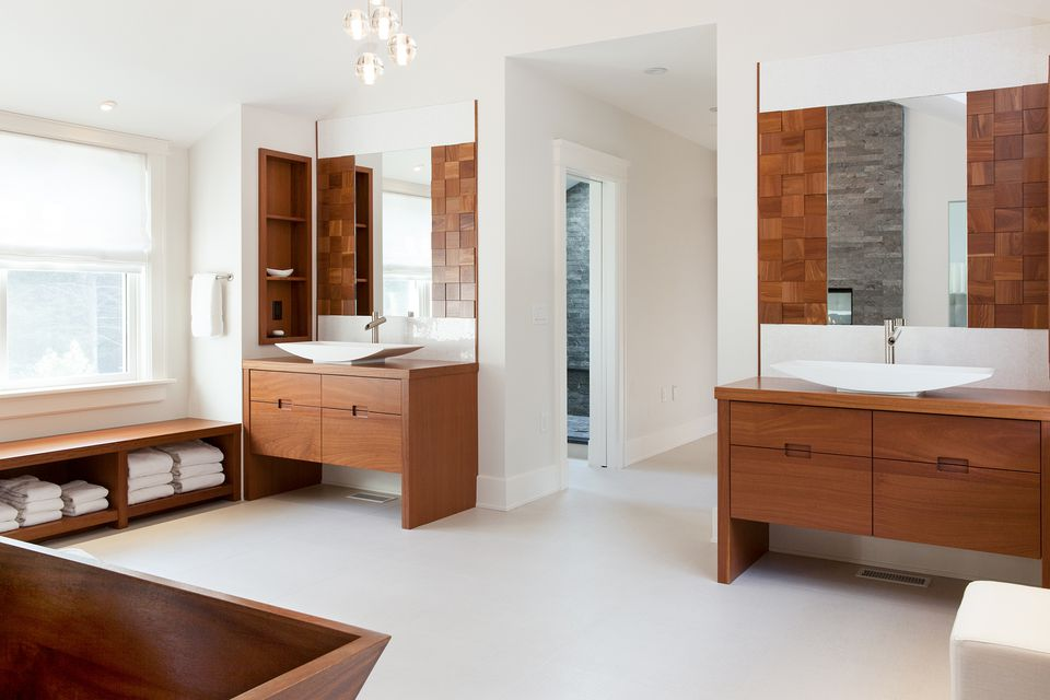 In an unusual touch, the master suite is entered through a grand bathroom. A local woodworker crafted the iroko vanities.