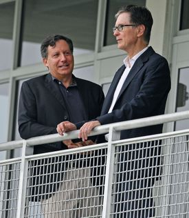 Red Sox owner John Henry said he and chairman Tom Werner (left) are determined to see the team get back on track in 2015.