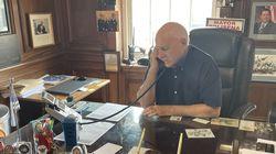 Mayor Joe Polisena works the phones in his Johnston office.