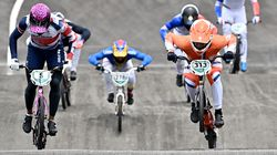 Britain's Kye Whyte (5) and Netherlands' Niek Kimmann (313) compete in the cycling BMX racing men's final.