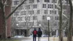 Students walk across campus at MIT in this March 2020 file photo.