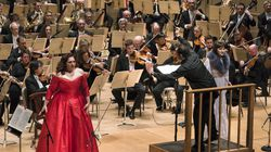 """Andris Nelsons leading the Boston Symphony Orchestra, with Christine Goerke, left and Gun-Brit Barkmin in """"Elektra,"""" in 2015."""