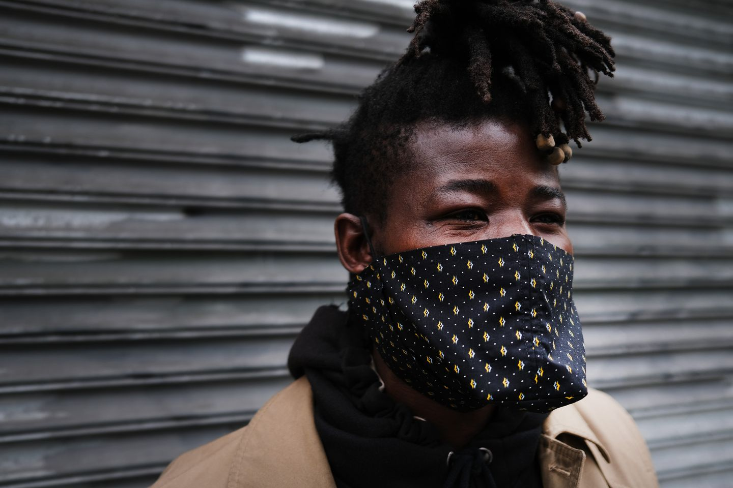 A man pauses with his homemade face mask in New York.