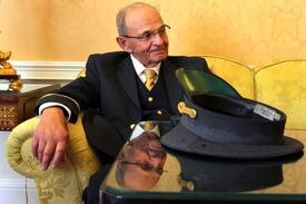 Norman Pashoian took a break Wednesday. He said he went through more than a dozen hats during his career.