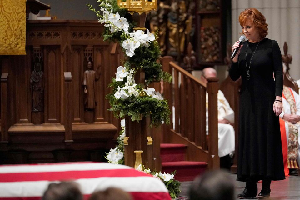 """Reba McEntire sings """"The Lord's Prayer"""" during a funeral service."""