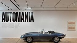 """Installation view of """"Automania,"""" with Jaguar E-Type roadster, at the Museum of Modern Art."""