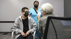 Nathalia Arboleda stood nearby as her 15-year-old son Simon Arboleda prepared to receive the COVID-19 vaccine from Dr. Nancy Serrell, right, during a vaccine clinic offered by the East Boston Neighborhood Health Center at the Chelsea Collaborative on Thursday afternoon.