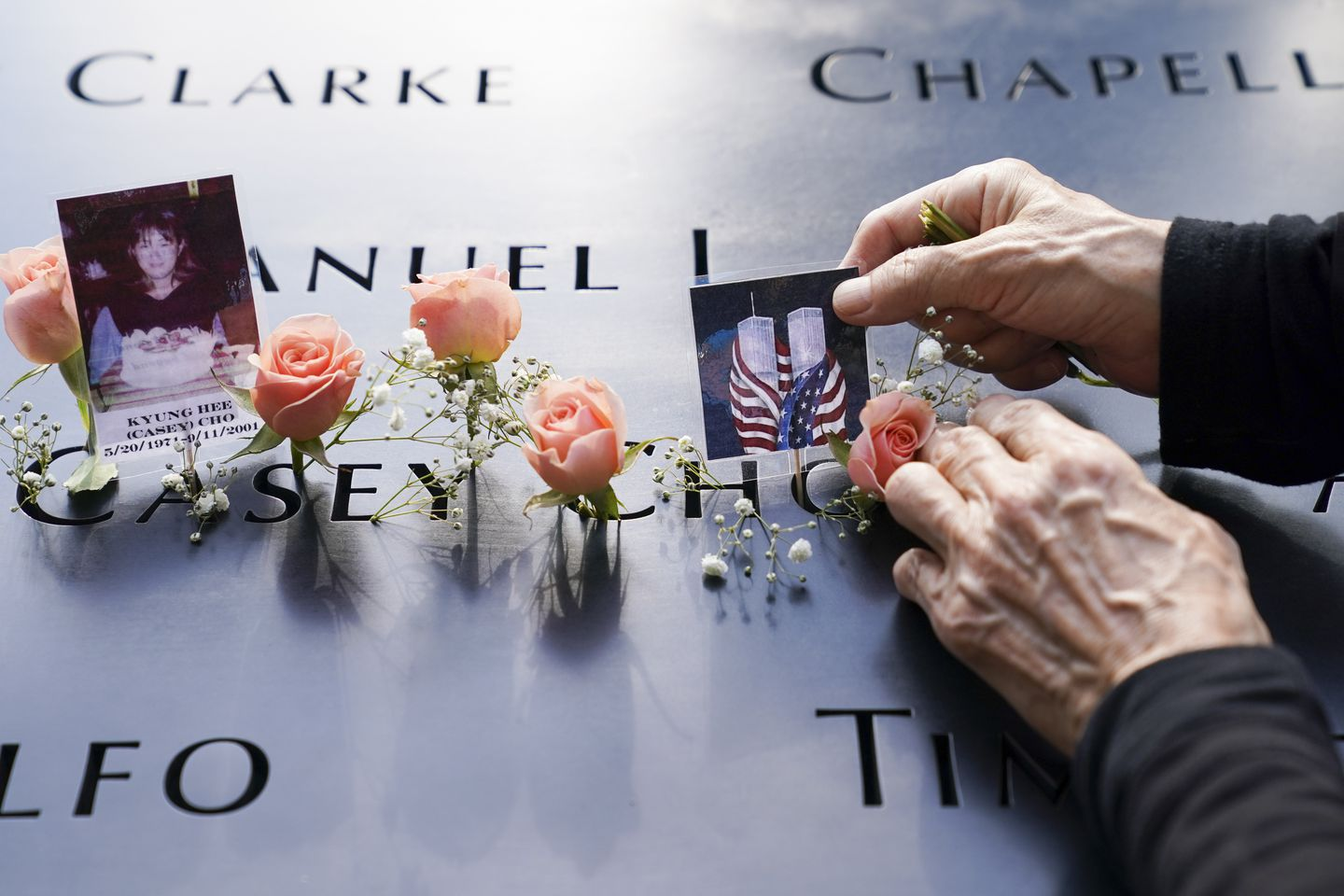 Flowers and pictures are placed at the National September 11 Memorial and Museum in New York.