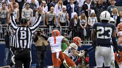Illinois wide receiver Casey Washington (14) put the exclamation point on the Illini's 20-18 upset over No. 7 Penn State after catching a pass for a 2-point conversion in the ninth overtime.